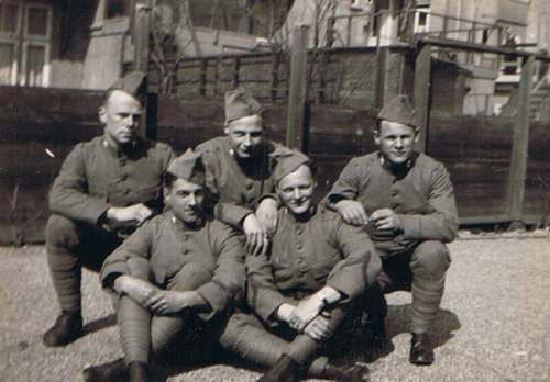 My father is on the left of this picture, in the front row.  Note the red cross emblem on his collar, showing his service in the Medical Troops.
