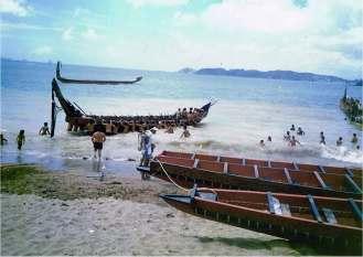 Launching 'waka' (canoes) off the beach at Paihia.