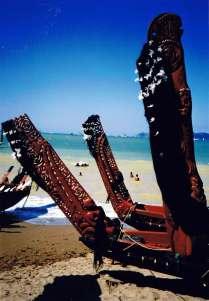 Carved sternposts of beached 'waka' (canoes) on the beach near Waitangi.
