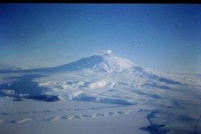 Mount Erebus seen from the air, with a glacier in the foreground.