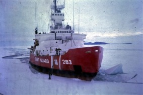 One day I flew out in a helicopter to deliver mail to the Coast Guard icebreaker cutting a channel for our re-supply ship.